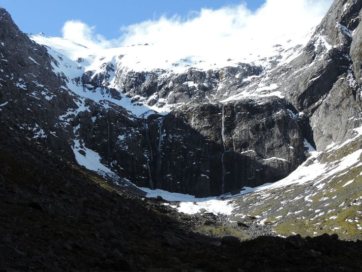 Waterfalls and lots of snow at the east side of the Homer Tunnel near Milford Sound.
