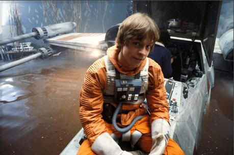 Mark Hamill posing on the full scale X-Wing on the Dagobah set.
