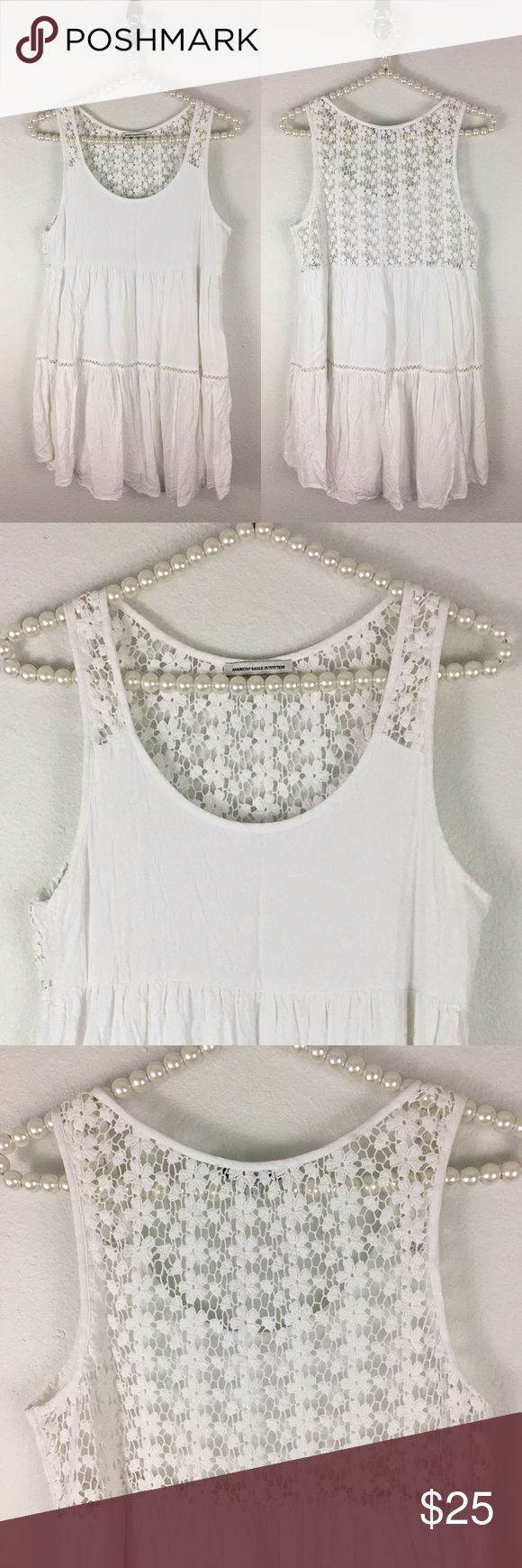 AE 🌻Festival Crochet Back Dress Sz Sm Super cute and super easy to wear - throw on some sandals and you are ready to go ! The back makes the dress ! Fully lined so it's white but not see thru - dress is made of 100% Viscose and Crochet and Lining are 100% Cotton. Sz Small Bust is approximately 17 inches measured flat and Length is shoulder to hem approximately 31 inches. Dress is A line shape. In great preworn condition. American Eagle Outfitters Dresses Mini