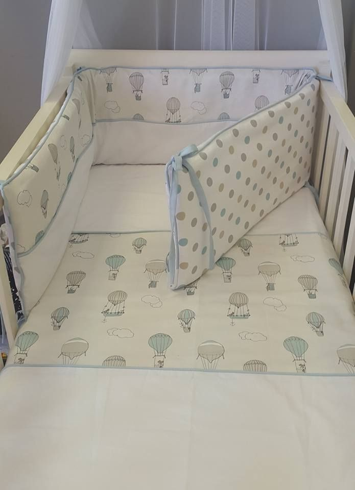 Cot duvet cover and padded cot bumper fashioning our Up and Away, Blue fabric; which is printed especially, and exclusively, for Studio Collection.