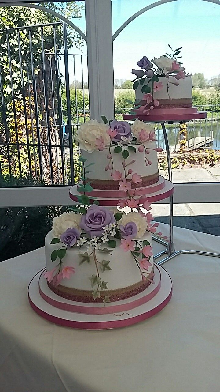 3 separate tier wedding cake with flowers Tiered wedding