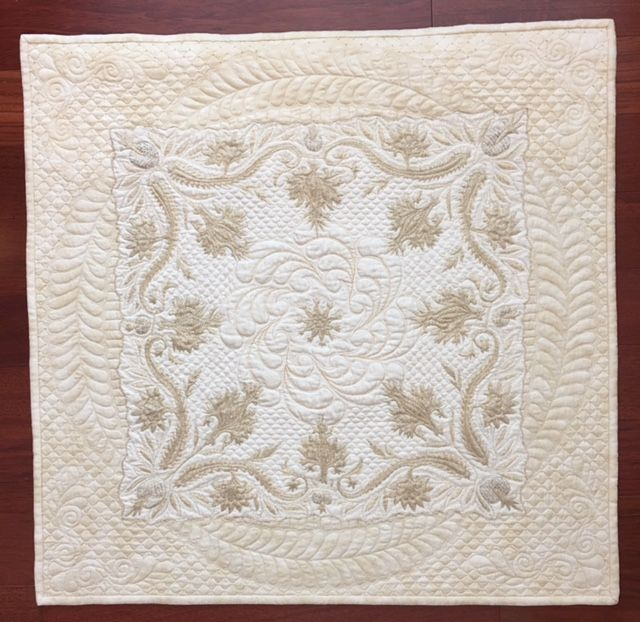 Gorgeous wholecloth linen quilt done by Kathy Heystee.