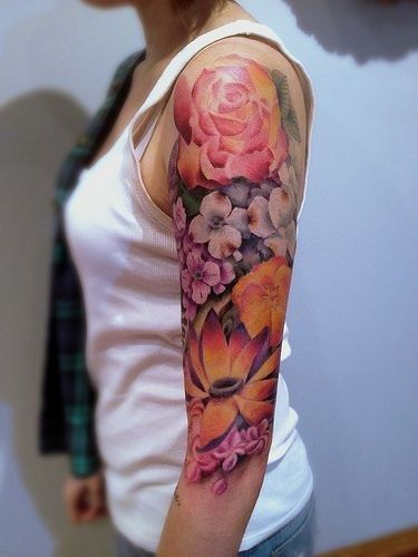 This vibrant floral burst:   23 Stunningly Delicate Tattoo Sleeves That Are Beyond Dreamy