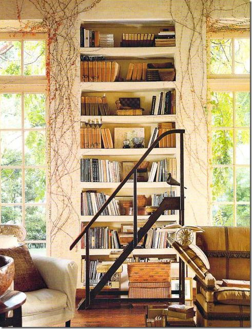 Rose Tarlow/ designer . . .love how she has welcomed the garden vines into her library . . .charming . . .
