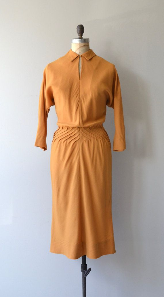 Vintage 1940s Claire McCardell dress in mustard wool with high keyhole collar, dolman sleeves, diagonally pintucked waist and metal back zipper. --- M