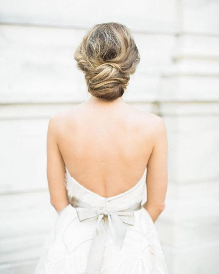 Soft and messy chignon by Atlanta based hair and makeup artists at Cucumber & Mint | Wedding Sparrow