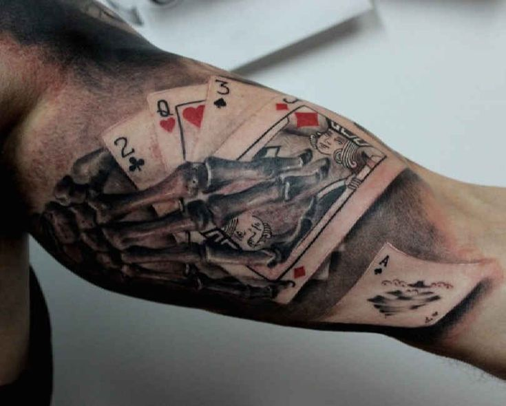 upper arm tattoo playing cards skelet http. Black Bedroom Furniture Sets. Home Design Ideas
