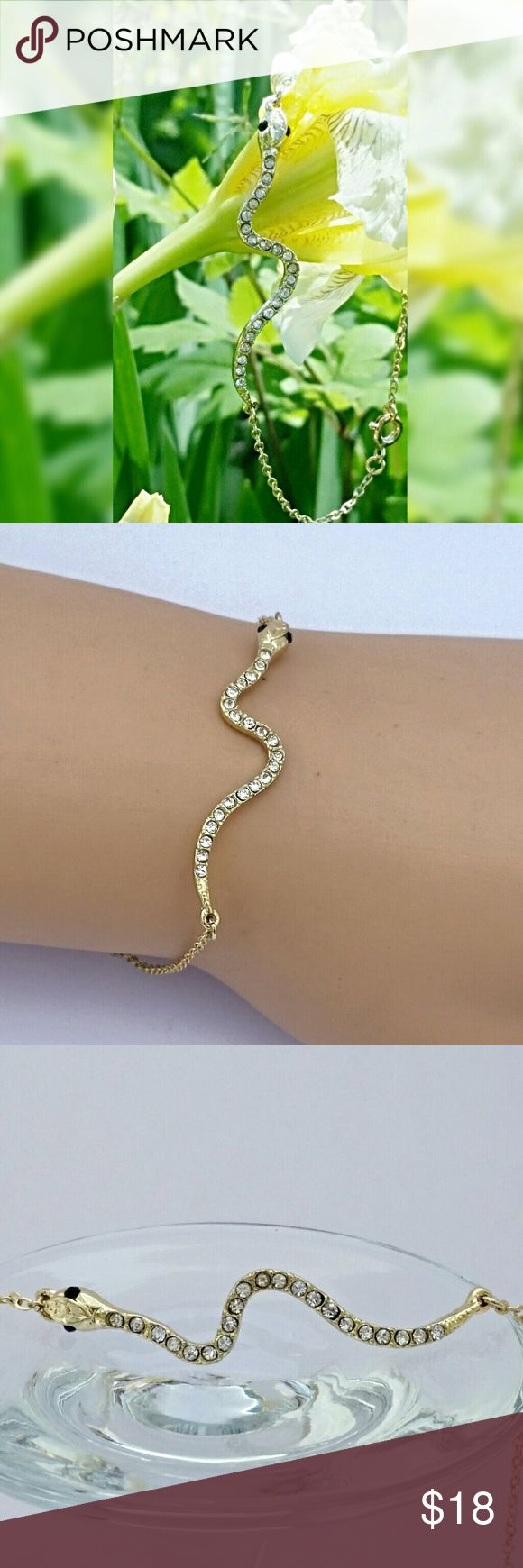 """Snake Bracelet Show off your unique style in this slinky snake bracelet. 2"""" long snake is adorned with crystals on a fine gold toned chain. 7""""long. Lady Adorned Boutique Jewelry Bracelets"""