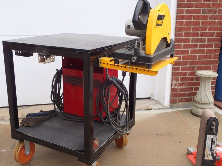 Portable welding table with equipment mounts.