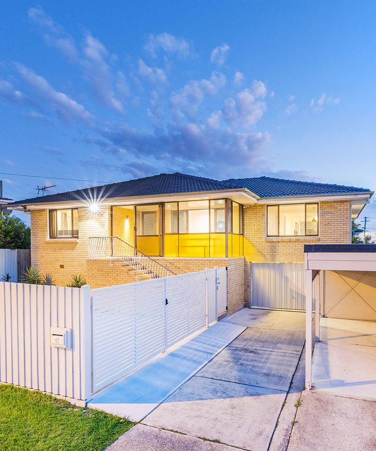 MANSFIELD 43 Aminya Street... Well appointed over two spacious levels, this elevated home offers a superb elevated aspect in Mansfield with leafy suburban outlooks.