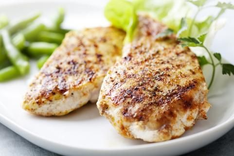 Kick up grilled chicken breast by mixing up the following marinade in a bowl: 1 cup plain low-fat yogurt 2 teaspoons cumin 1 tablespoon lemon juice 1 crushed garlic clove 1 tablespoon cilantro Place chicken breasts in a covered dish with the marinade and shake to coat the chicken well, then let it soak up the flavors in the refrigerator for 4 hours. Grill or broil as usual.