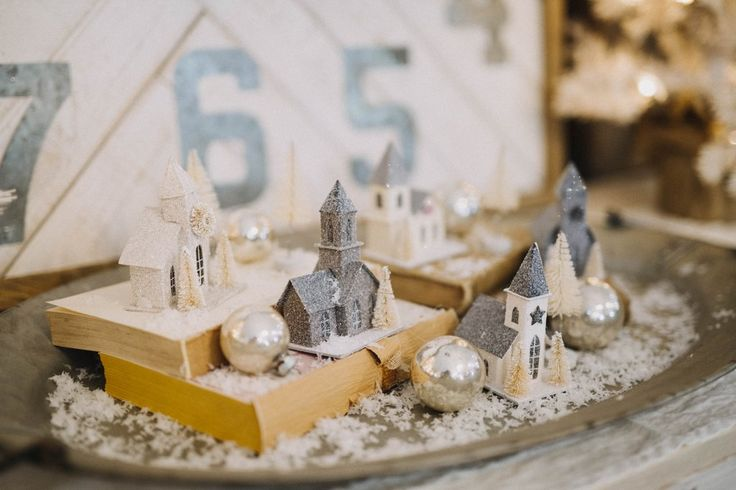 In store top seller!! It's a display in a box. Set up this little village on our galvanized tray with vantage books and your work is done! Beautiful soft colo