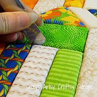 Faux quilted bulletin board created from styrofoam and fabric scraps