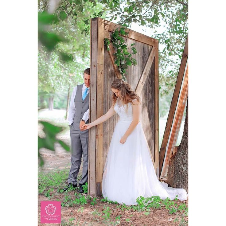 On their Wedding Day, bride and Groom share a prayer between a door before walking down the aisle.