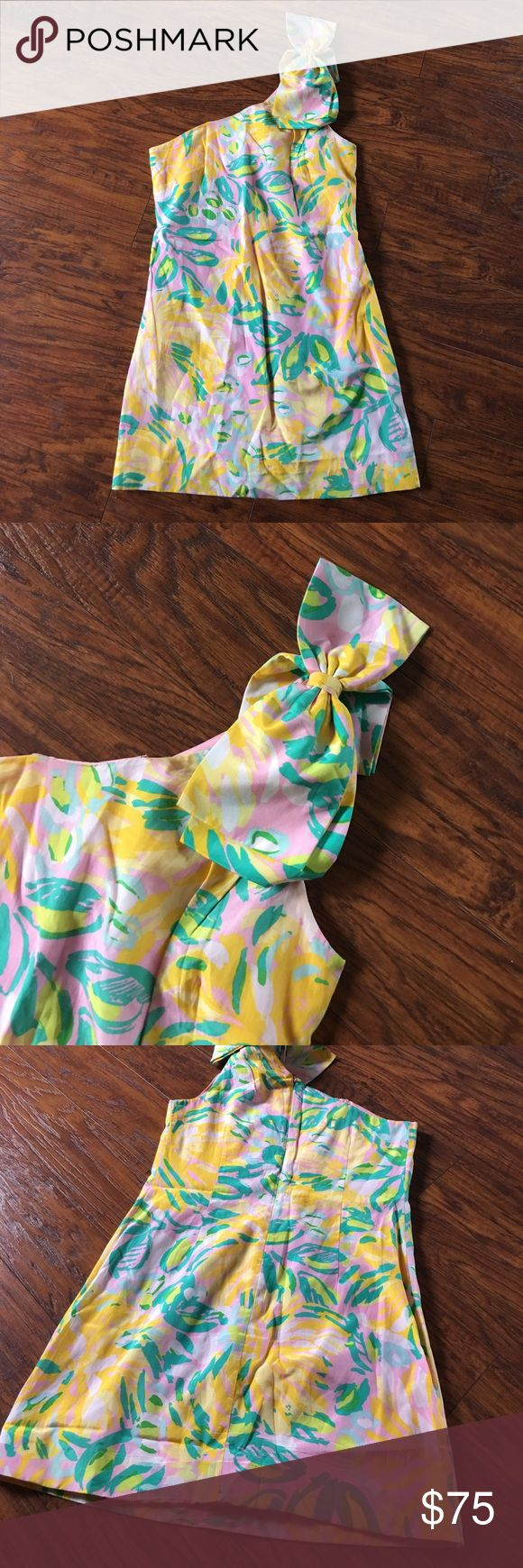 "SALE❤️☀️Lilly Pulitzer Chloe Lilet Blossom Dress Beautiful Lilly Pulitzer dress with a one shoulder strap and bow on top. From the top of the shoulder to the bottom of the dress is 31 1/2"". Great condition. There is a small amount of make up inside chest of dress but it's pictured and cannot see from the outside. Lilly Pulitzer Dresses Mini"