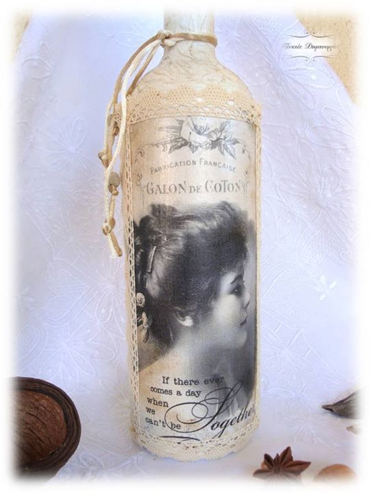 Decoupage on a wine bottle... Lace, cords and lava beads embrace this incredible illustrated figure
