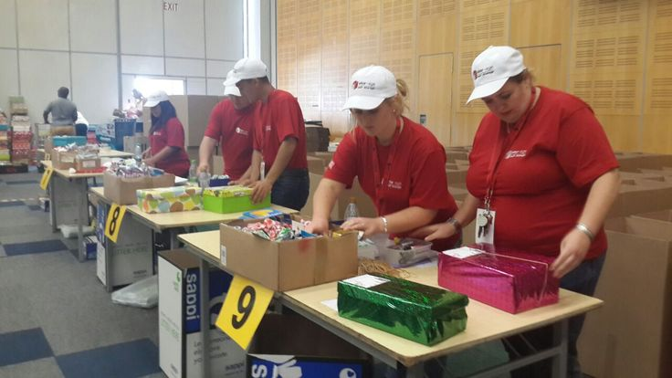 Stor-Age worker bees checking the Santa Shoeboxes to make sure each child receives all the specified items.