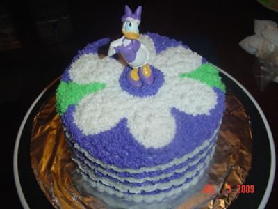 Daisy Duck Cake:  Simple Star Tip, with cake toppe