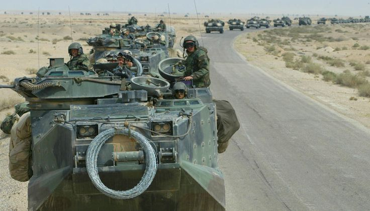Nine Years of War in Iraq - U.S. Marines from Task Force Tarawa roll through the Iraqi countryside in their armored assault vehicles March 22, 2003 on their way to an objective in Iraq. U.S. and British forces continued to fight in Iraq as they tried to topple the regime of Iraqi President Saddam Hussein. (Photo by Joe Raedle/Getty Images)
