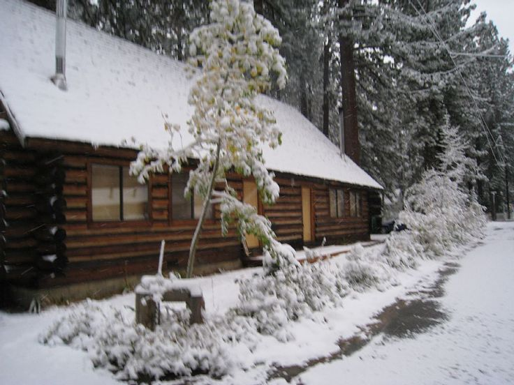 This authentic, hand-made log cabin 'duplex' boasts of a Rustic elegance. This spacious yet intimate lodging is romantic for two, yet its open, roomy floor plan can comfortably accommodate 4 Adults or a family ...