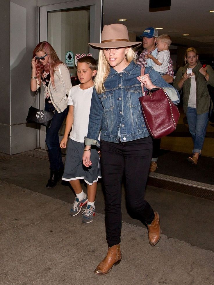 Reese Witherspoon, Ava Elizabeth Phillipe, Deacon Reese Phillipe, Tennessee James Toth, and Jim Toth seen at LAX.