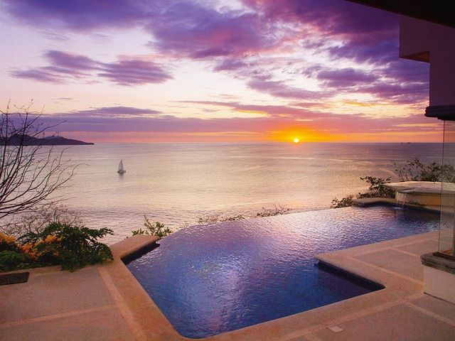 Casa Bananluna is a unique ocean front home. Look at this beautiful sunset! Playa Flamingo, Costa Rica