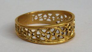 OPEN RING WITH ETERNITY SIGNS, BRASS