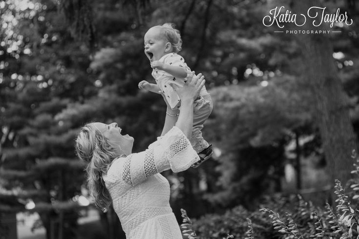 Mother lifts son in the air. Brueckner Rhododendron Park. Toronto Family Photography