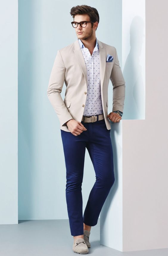 A smart casual combination of a cream coat and navy chino pants can maintain its relevance in many different circumstances. Throw in a pair of cream suede driving shoes for a more relaxed feel.   Shop this look on Lookastic: https://lookastic.com/men/looks/blazer-long-sleeve-shirt-chinos/20918   — White and Navy Polka Dot Long Sleeve Shirt  — Light Blue Pocket Square  — Beige Blazer  — Beige Leather Belt  — Navy Chinos  — Beige Suede Driving Shoes