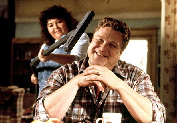 Roseanne Barr and John Goodman  in the sitcom Roseanne. For the Best Comedy Shows slide show.
