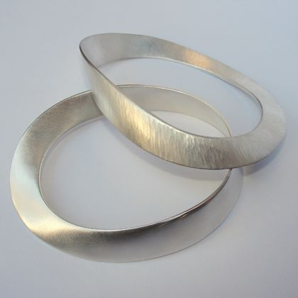 Forged anticlastic bracelets by Anna Schmid