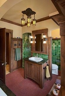 I love the Craftsman aesthetic and these green tiles are fantastic. Having the toilet hidden behind the vanity is interesting.