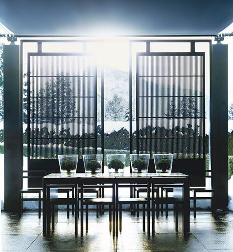 """""""It's a strong, modern home in a conservative suburban setting,"""" Anouska Hempel says of a Neoclassical villa she designed in Salzburg, Austria. Hempel designed the lattice screens and the table on the poolhouse terrace, where retractable canopies """"allow outdoor dining regardless of the weather,"""" she says. December 2006"""