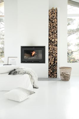 MARADADI Design & Interiors loves this pin. Horizontal meets vertical. Gas glass fireplace and wood nook - the symmetry is perfect.