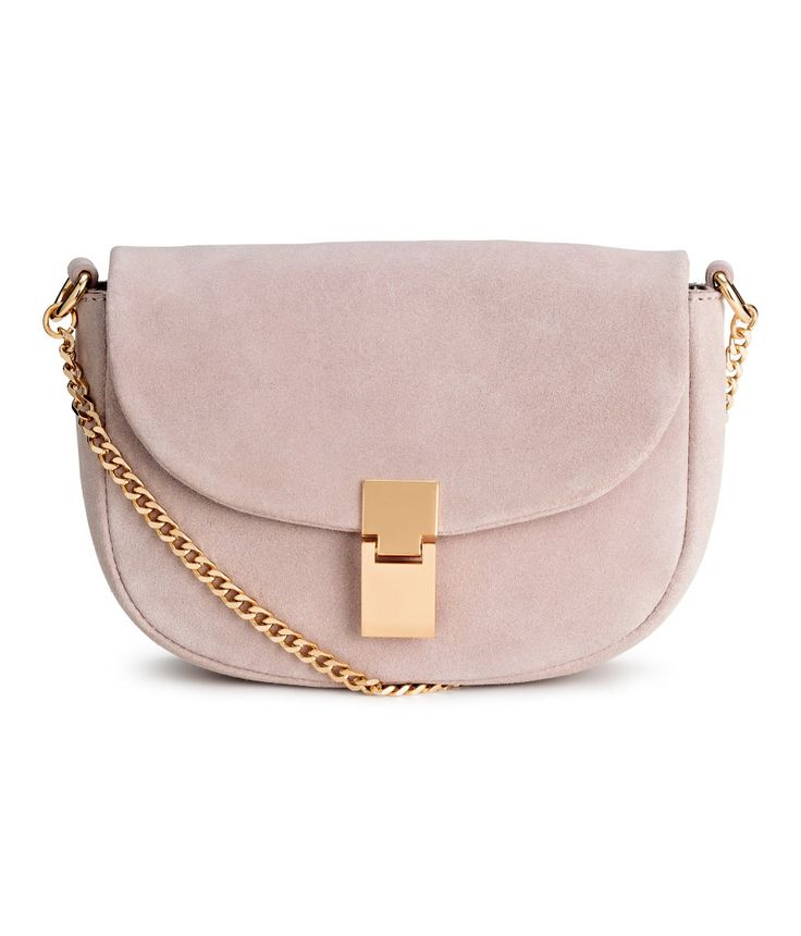 Check this out! PREMIUM QUALITY. Suede shoulder bag with a magnetic metal fastener, suede and metal chain shoulder strap, and inner compartment with zip. Lined. Size 1 3/4 x 5 1/2 x 8 in. - Visit hm.com to see more.