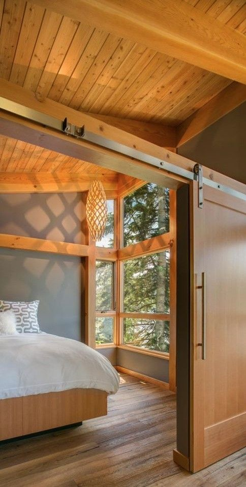 Check out the view, the light, and the shadow from that light fixture! Truly fab. This 550 sq. ft. timber framed cabin by FabCab is in Lake Pend Oreille, Idaho assembled by Selle Valley Construction. | Tiny Homes