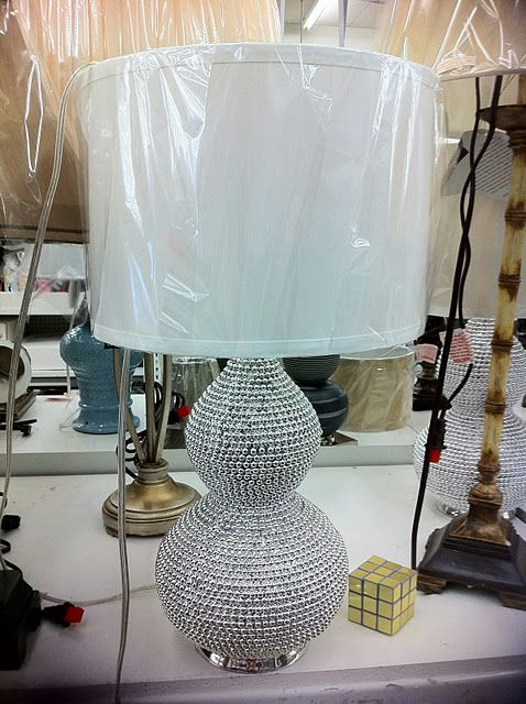 glue mardi gras beads to a lamp and spray paint silver!  genius!