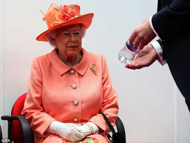 The 91-year-old monarch was presented with a specially-labelled bottle of Highland Spring water she helped make after pressing the button to start the new production line