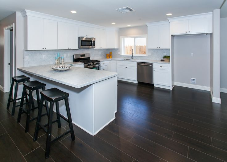 White cabinets, gray tile and counters, dark wood floors - contemporary kitchen