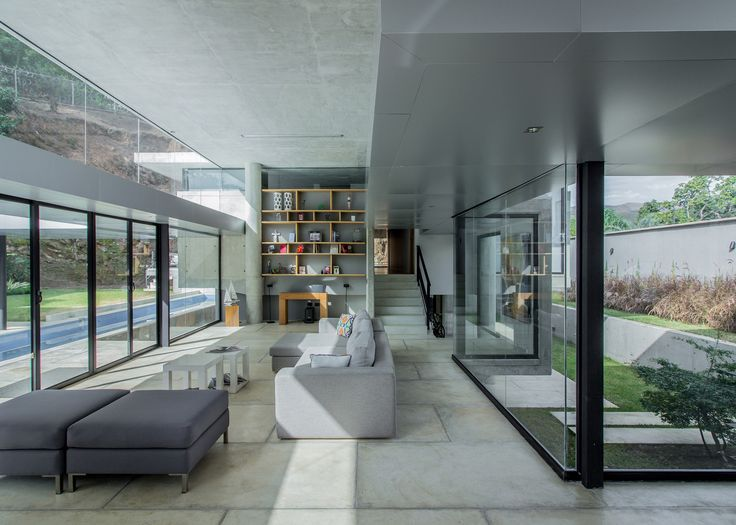 NMD Nomadas Has Arranged This Concrete And Glass House In Valencia,  Venezuela, Around A