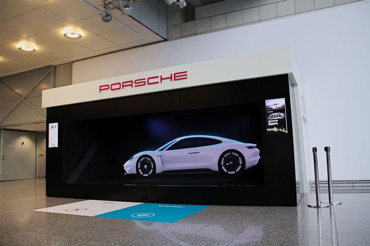"""Im September 2015 zeigt Porsche am Flughafen Frankfurt in Terminal 2 seine Vision eines vollelektrischen, viersitzigen Sportwagens – die """"Mission E"""" – als Hologramm in Originalgröße. Idee und Konzept kommen von der UDG United Digital Group, der Digitalen Leadagentur für Porsche."""