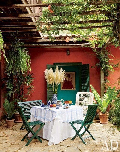 Enjoying breakfast at this dining patio area covered with lush foliage