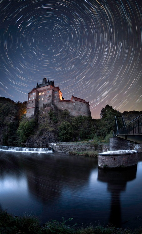 "Star trails over ""Castle Kriebstein"" in Middle Saxony, Germany.       Medieval Kriebstein Castle is situated right at the center of a triangle between the cities of Dresden, Chemnitz and Leipzig, and is first officially recorded on October 4, 1384.    Built on a steep rock, the castle's 147 foot tall tower soars over the River Zschopau, which surrounds it on three sides.     Photo by Christoph Schaarschmidt."