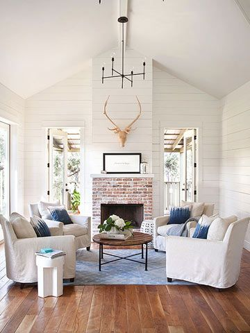 I would like to white wash our fireplace to look like this one; lighter, but still clearly brick.