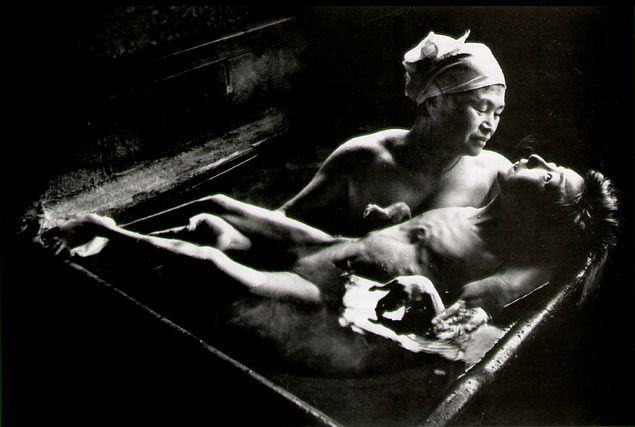 W. Eugene Smith Tomoko Uemura in Her Bath Minamata, 1972  © The Heirs of W. Eugene Smith