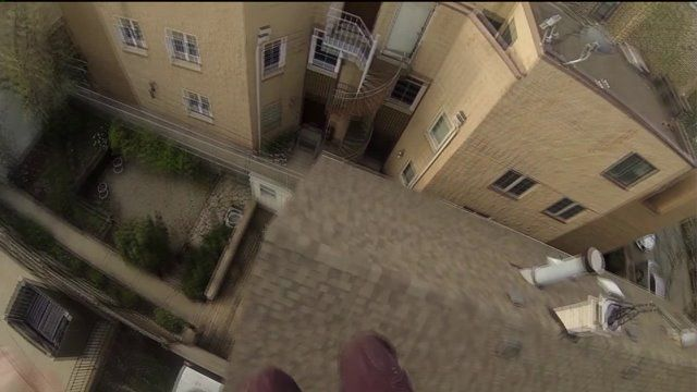 Professional stunt man Ethan Swanson takes a flier off of a rooftop in Chicago, Illinois. FULL VIDEO