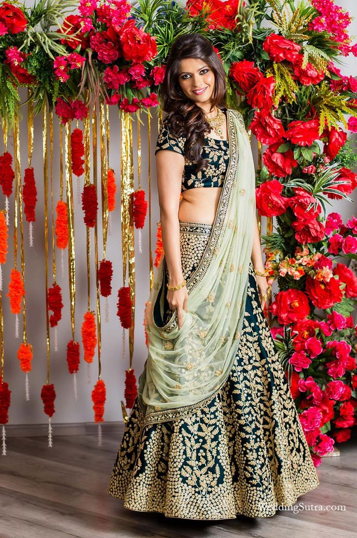 A dark Green Lehenga with embellishments paired with a Mint Green dupatta by Kalki Fashion for Real Bride Shivani Naik at WeddingSutra on Location. #weddingsutra #bridallehenga #lehenga #Indianbride #Indianoutfit #bridallook #weddingideas #desibride #bride #bridaloutfit #designer #kalkifashion #mintgreen #green
