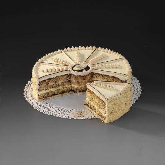 Tort Prowincja Podstawą smaku jest biszkopt z chleba razowego z dodatkiem dobrej belgijskiej czekolady, przekładany dwoma rodzajami kremu sporządzonego ze świeżego masła, pasteryzowanych żółtek i świeżych ziarenek wanilii. Dolną warstwę stanowi konfitura ze śliwek.