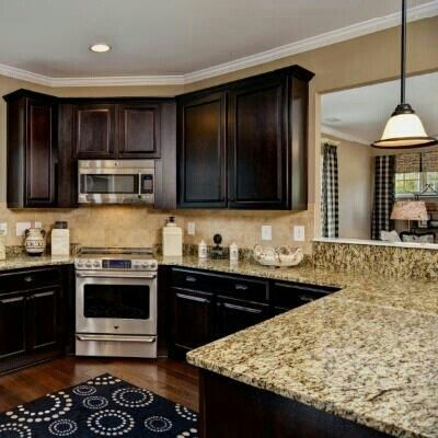 Dark wood and another corner stove kitchen ideas for Granite colors for black cabinets