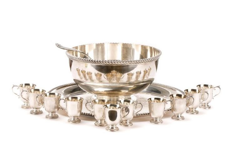 """Gorham (American (Rhode Island), founded 1831). A thirteen piece silverplated punch set comprising the footed punch bowl, matching tray, ladle and eleven footed punch cups. Each piece hallmarked for Gorham and """"EPNS"""". The punch bowl stamped """"Y1078"""". Approximate height 8.25"""", diameter 14.62"""". Tray stamped """"Y1093"""". Approximate height 1.5"""", diameter 22"""". Cups stamped """"Y1079"""". Approximate height 3.25"""". Ladle approximately 13.5"""" long."""